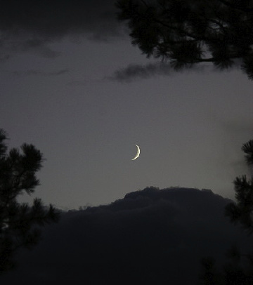Crescent Moon over Wet Mountains. Photo copyright Chas S. Clifton.